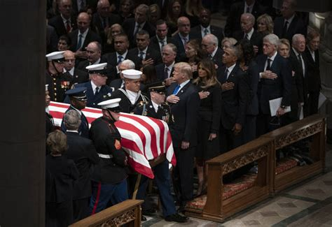 Bush saluted with praise, humor, cannons at capital